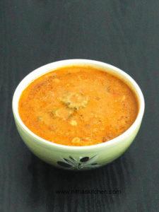 Araithuvitta Pavakkai Puli Kuzhambu   Bitter Gourd in Coconut and Tamarind Sauce