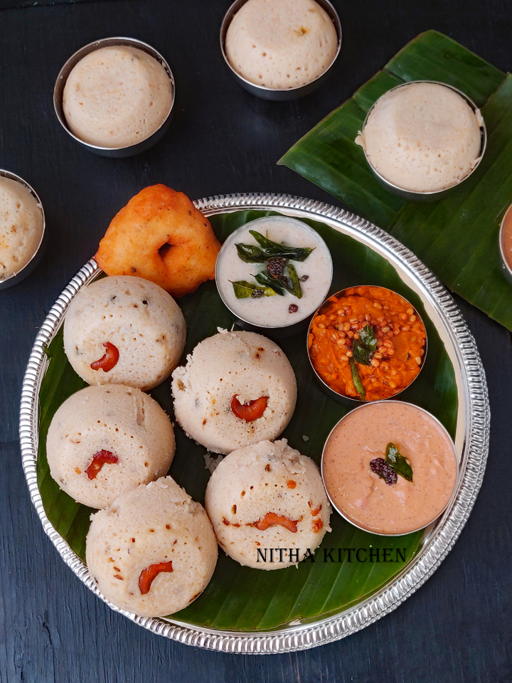 Traditional Kancheepuram Idli using millet, classic millet kanchipuram idli, millet milagu idli, millet kanchipuram idli, kanchivaram idli, milagu idli recipe, how to steam idli in instant pot, hot to use steam option in Instant pot, how to set steam in instant pot, instant pot idli recipe, instant pot millet idli, thinai kanchipuram idli, thinai idli recipe, soft millet idli, soft fluffy millet idli, millet idli recipe, IP idli recipe, Instant pot idli, how to make millet idli dosa batter, millet idli dosa batter, no idli plate idlis, how to steam idli without idli plates, idli without idli plates, idli in cups, steam dili in cups, how to steam idli in stainless steel cups, idli in stainless steel cups, namma ooru idli recipe, kanchi idli recipe, thinai arisi idli recipe, millet flour idli recipe, how to grind urad dal for idli, idli batter with tempering, tempered millet idli batter, seasoned millet idli batter, beginner millet idli recipe, beginner milagu idli recipe , kanchipuram idli recipe, foxtail millet idli, foxtail millet kanchipuram idli, foxtail millet recipe ideas, foxtail millet recipe, whole grain foxtail millet recipe, foxtail millet flour recipe ideas, positive millet recipe, positive millet idli recipe, positive millets recipe ideas, millet milagu idli recipe,millet kanchipuram idli,how to steam idli in instant pot,instant pot idli recipe,instant pot millet idli,thinai kanchipuram idli recipe,soft fluffy millet idli,millet idli recipe,Instant pot idli,how to make millet idli dosa batter,millet idli dosa batter,no idli plate idlis,idli in stainless steel cups,thinai arisi idli recipe,millet flour idli recipe,seasoned millet idli batter,foxtail millet idli,foxtail millet kanchipuram idli